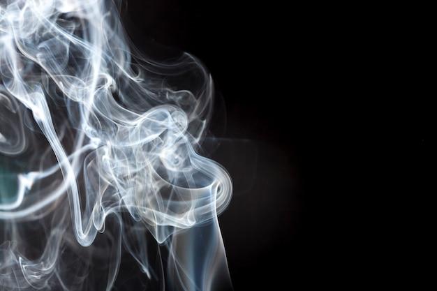 Black background with smoke