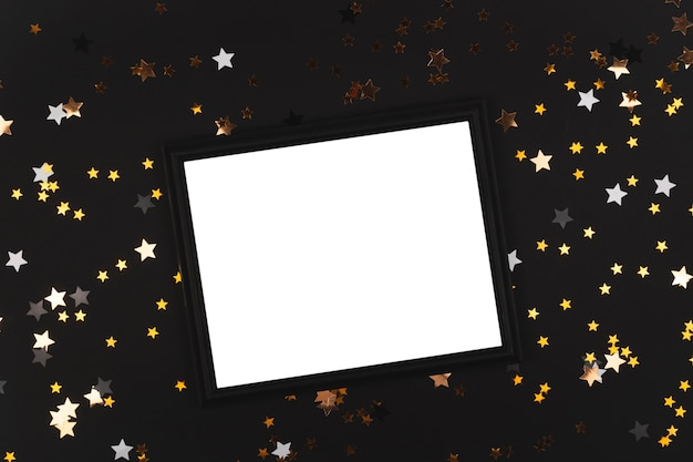 Black background with stars that shine with black frame mock up happy new year background copy space