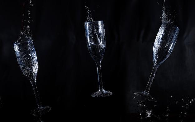 Sfondo nero con tre bicchieri d'acqua