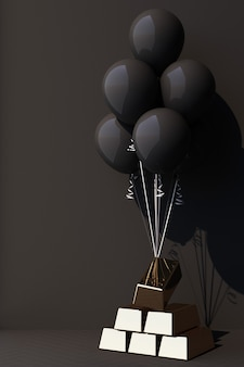 黒い風船が金の棒で縛られて引き上げられている