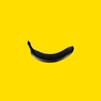 Black banana on yellow background pop art graphic pattern