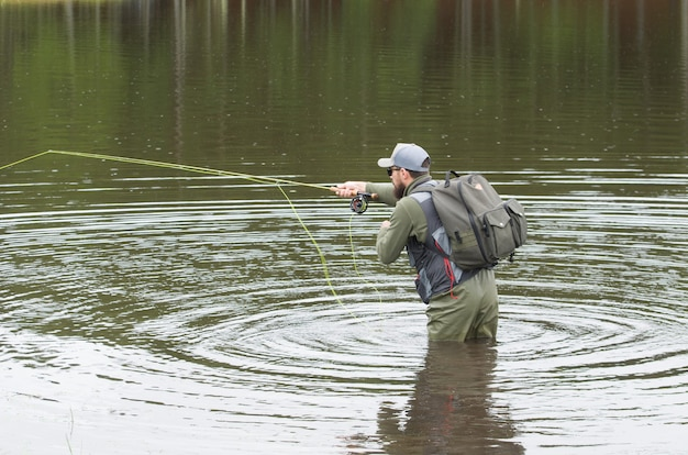 Black bass fisherman fishing inside lake