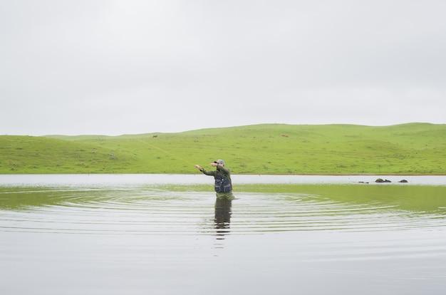 Black bass fisherman fishing with flyfishing