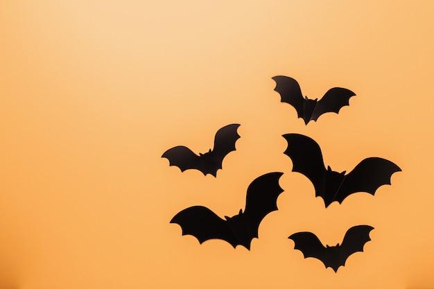 Black bats on orange background