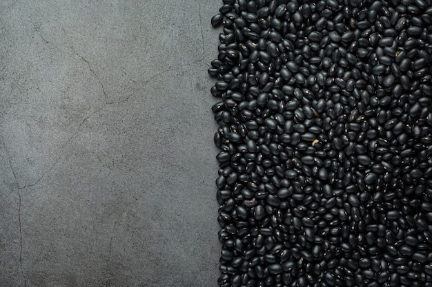 Black beans and bare cement background