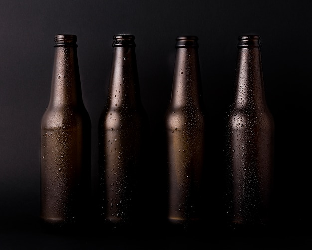 Black beer bottles line