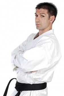 Black belt karate expert over white background