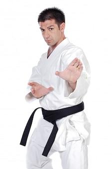 Black belt karate expert with fight stance