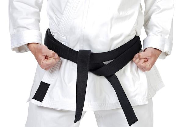 Black belt karate expert with rest position