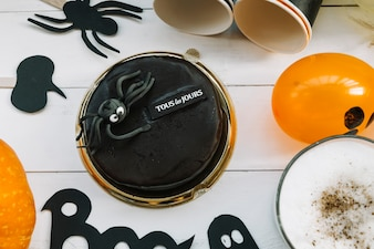 Black biscuit with decorative spider in Halloween style