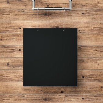 목재 벽 배경에 매달려 있는 검은색 빈 프레임