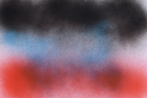 Black, blue and red spray paint on white paper