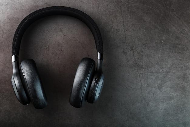 Black bluetooth headphones on dark