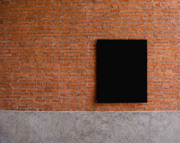 Black board on red brick wall