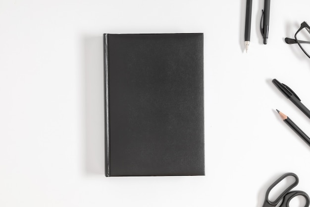 Black book cover mock up and stationery on white background