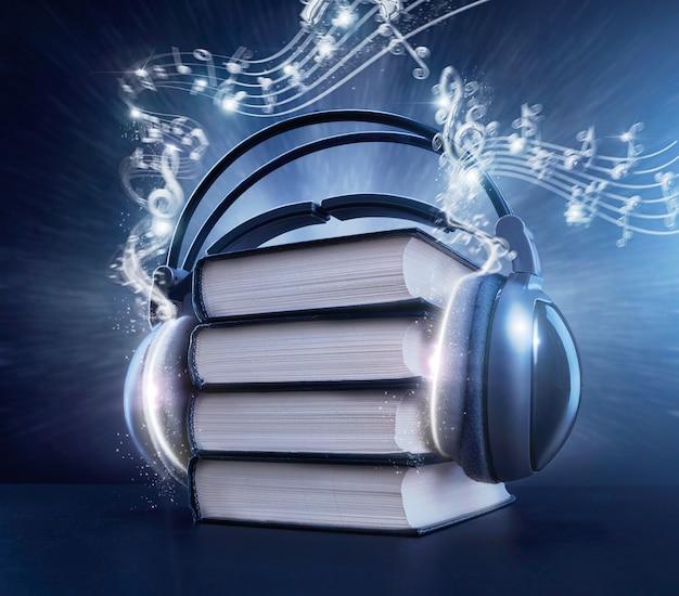 Черные книги с наушниками и синими волшебными нотами