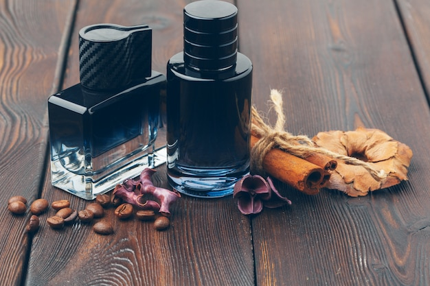 Black bottle of perfume placed on a wooden table