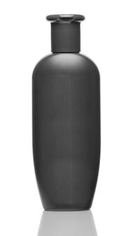 Black bottle of shampoo isolated on white background close up