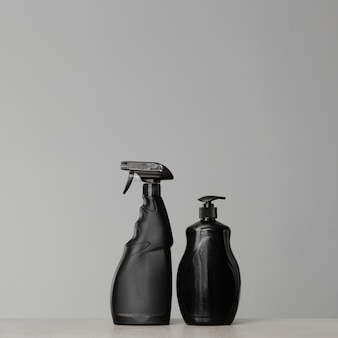 Black bottles with dish detergent dispenser and fat removal spray