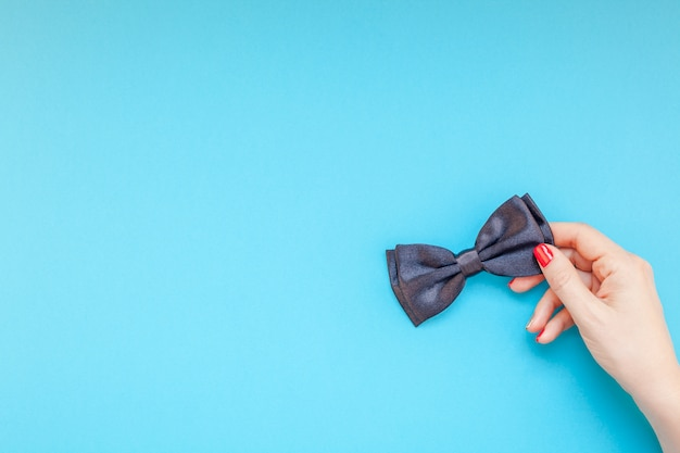 Black bow tie woman hand for men fathers concept