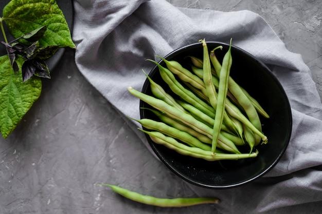 Black bowl with fresh green string beans