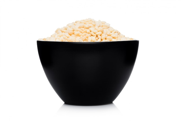Black bowl with natural organic granola cereal corn rice on white