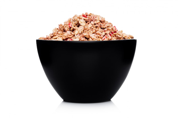 Black bowl with natural organic granola cereal