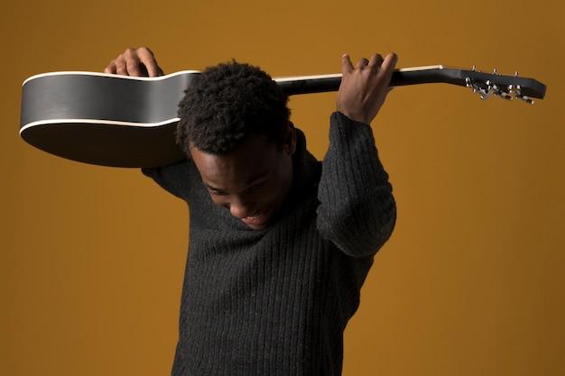 Black boy playing the guitar