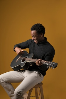 Black boy playing the guitar