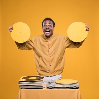 Black boy posing with vinyls