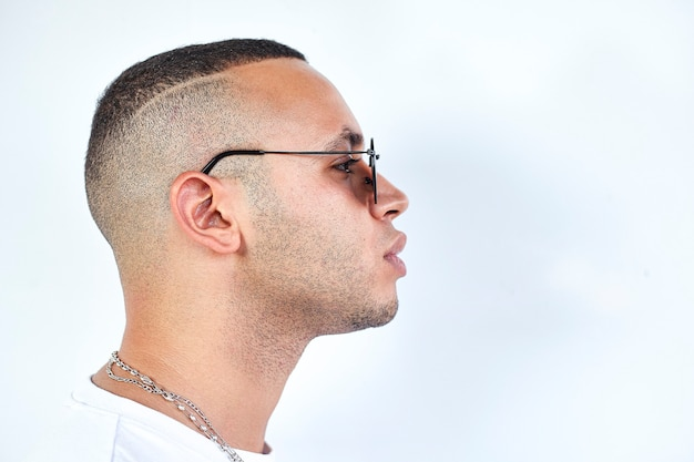 Black boy with sunglasses in profile on a white background