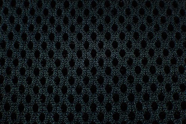 Черная плетеная хлопчатобумажная сетка текстуры фона. закройте вверх.