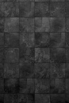 黒レンガの建物の壁。モダンなロフトのインテリア。デザインの背景