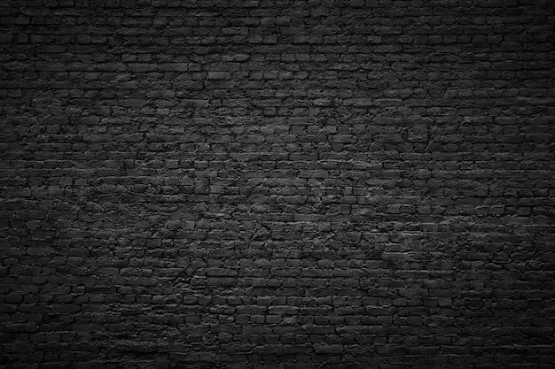 黒レンガの壁の背景、ヴィンテージの石のテクスチャ