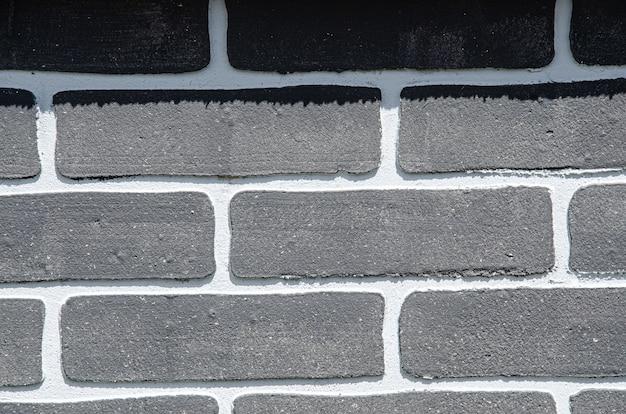 黒レンガの壁の背景、レンガの部屋、インテリアテクスチャ、壁の背景。