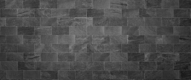 設計のための黒いレンガの壁のレンガの背景
