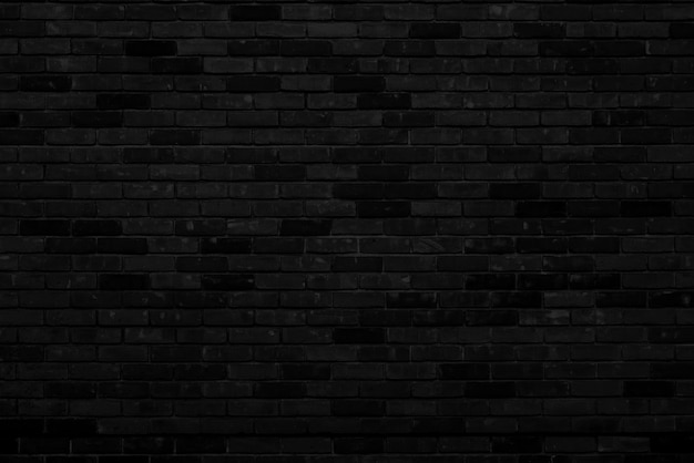 Black brick wall facade of an old building