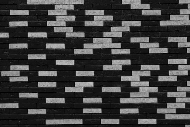 Black brick wall. loft interior design. black paint of the facade.