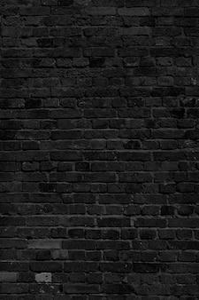 Черная кирпичная стена. лофт дизайн интерьера. черная краска для фасада.