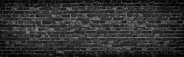 고해상도의 탁 트인 전망의 검은 벽돌 벽