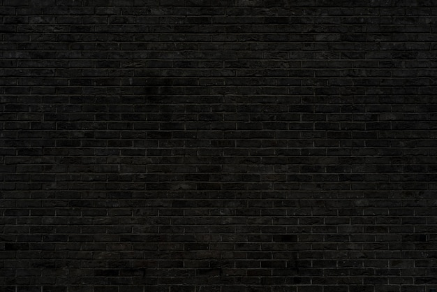 Black brick wall texture. building architectural background.
