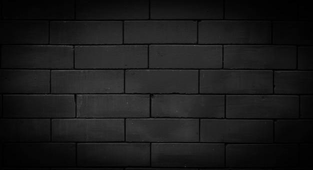 漆喰の背景や質感ではない黒いレンガの壁。