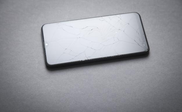 Black broken smartphone. broken screen