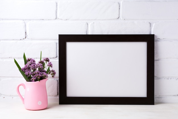 Black brown  landscape frame  with purple flowers in pink rustic pitcher