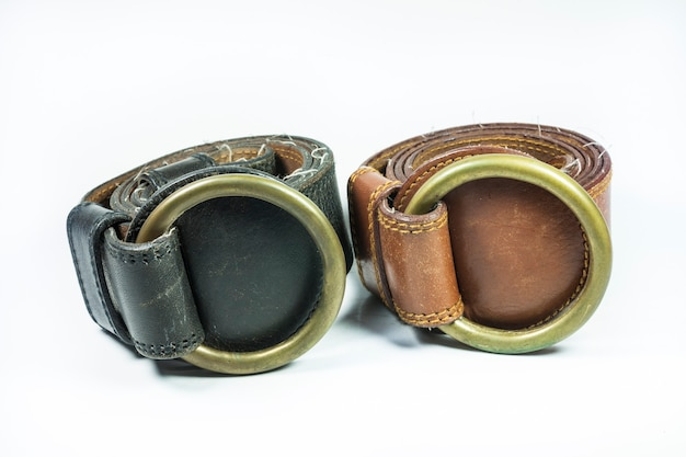 Black ,brown leather belt  on a white background.