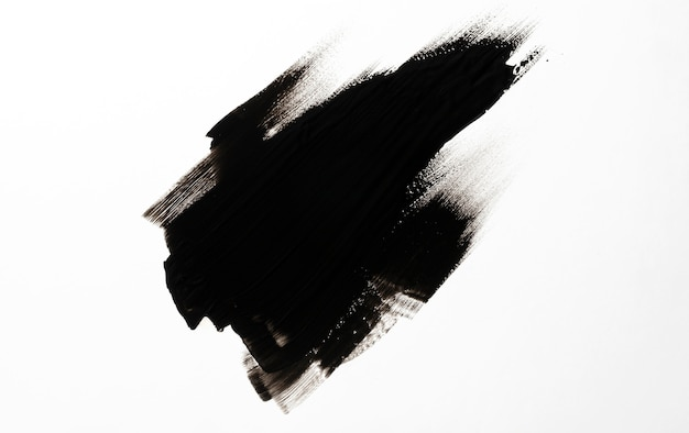 Black brush stroke on white background