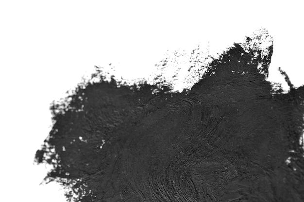 黒いブラシは白い紙に油絵の具を撫でます。白い背景で隔離。抽象的な創造的な背景