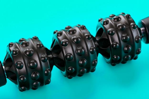 Black bumpy foam body massage roller