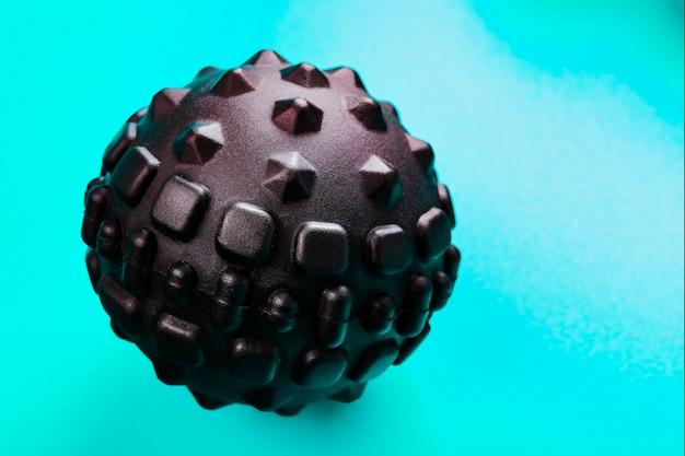 Black bumpy foam massage ball is a rubber ball