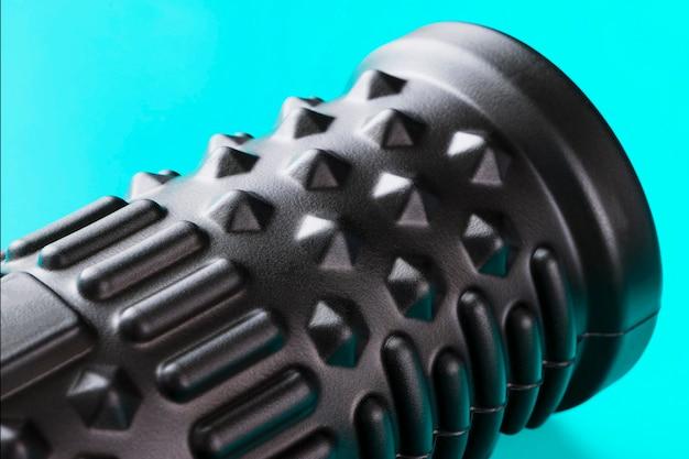 Black bumpy foam massage roller, body roller